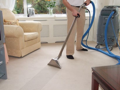 cleaning expert cleaning carpet with his vacuum cleaner in pleasantville